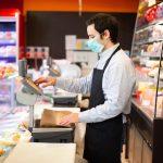 grocery clerk wearing mask
