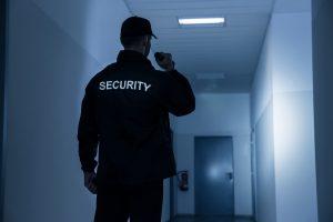 guard patrolling with flashlight